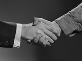 Close-Up Handshake Between Businessman and Laborer Photographic Print by H. Armstrong Roberts