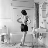 Back View of Woman in Bathroom Fastening Black Bra Photographic Print by H. Armstrong Roberts
