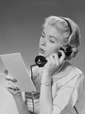 Blond Woman Talking on Telephone Reading List Photographic Print by H. Armstrong Roberts