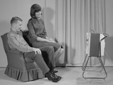 Couple Man Woman Sitting Chair Watching Portable Television Photographic Print by H. Armstrong Roberts