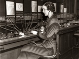1930s Woman Telephone Operator Sitting at Large Manual Switchboard Directing Calls Photographic Print by H. Armstrong Roberts