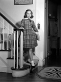 1950s Teenage Girl in Plaid Dress and White Ankle Socks on Stairway Holding Banister Photographic Print by H. Armstrong Roberts