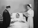 Man Doctor Woman Nurse Talking with Male Patient Lying in Hospital Bed Photographic Print by H. Armstrong Roberts
