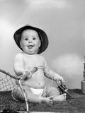 1960s Baby Girl Wearing Fishing Hat Holding Net and Reel Fishing Gear Photographic Print by H. Armstrong Roberts