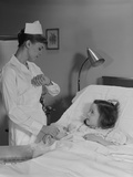 Woman Nurse Checking Pulse Taking Temperature on Little Girl Patient in Hospital Bed Photographic Print by H. Armstrong Roberts