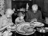 1950s-1960s Little Girl Looking at Turkey Sitting Between Grandmother and Grandfather Photographic Print by D. Corson