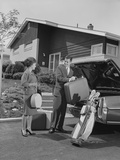 Couple Man Woman Packing Luggage into Car Trunk Photographic Print by H. Armstrong Roberts