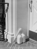 Glass Milk Bottles and Newspaper by Front Door Home Delivery Photographic Print by H. Armstrong Roberts