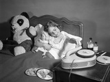1950s Sick Little Girl in Bed Playing with Record Player Photographic Print by H. Armstrong Roberts
