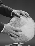 Male Hands Holding Earth Globe Photographic Print by H. Armstrong Roberts