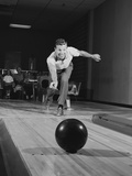 Man Releasing Ball Down Bowling Alley Lane Photographic Print by H. Armstrong Roberts