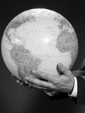 Mans Hand Holding Globe of the World Photographic Print by H. Armstrong Roberts