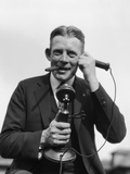 1920s Portrait of Businessman Talking on Candlestick Phone Smoking Cigar Office Indoor Photographic Print by H. Armstrong Roberts