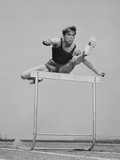 Running Man Jumping over Hurdle Photographic Print by H. Armstrong Roberts