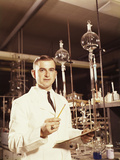 Scientist Conducting a Titration Experiment Photographic Print by H. Armstrong Roberts