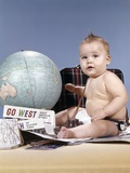 1960s Baby Boy Sitting by World Globe with Suitcase and Travel Paraphernalia Photographic Print by H. Armstrong Roberts