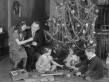 Family Christmas Photo Father Two Daughters and Son with Presents and Tree Fotografiskt tryck av H. Armstrong Roberts