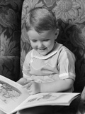 1930s-1940s Little Boy Sitting on Chair Reading Picture Book Photographic Print by H. Armstrong Roberts