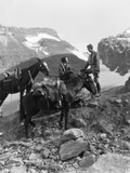 Couple Man Woman Wearing Riding Gear Jodhpurs Boots Spurs Sitting Standing on Large Rock Photographic Print by H. Armstrong Roberts