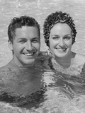 Smiling Couple Man Woman in Swimming Pool Photographic Print by H. Armstrong Roberts