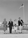 Group 4 High School Students Walking Past American Flag Carrying Textbooks Photographic Print by H. Armstrong Roberts