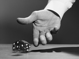 Man's Hand Rolling Dice Photographic Print by H. Armstrong Roberts