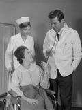 Man Doctor Woman Nurse Talking to Smiling Female Patient Sitting in Hospital Wheelchair Photographic Print by H. Armstrong Roberts