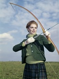 1960s-1970s Sports Woman Archer Holding Bow Preparing to Draw Arrow Photographic Print by H. Armstrong Roberts