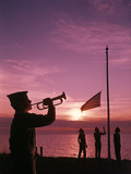 1960s Boy Scout Blowing Bugle as Others Raise American Flag at Camp Sunset Ceremony Photographic Print by D. Corson