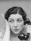 Young Brunette Woman with Surprised Expression Hand to Head Talking on Telephone Photographic Print by H. Armstrong Roberts