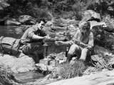 Couple Having Picnic Sitting on Rocks Photographic Print by H. Armstrong Roberts