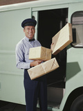 Delivery Truck Driver Holding Packages Photographic Print by H. Armstrong Roberts