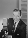 Man Speaking into Microphone Radio TV Announcer Broadcaster Photographic Print by H. Armstrong Roberts