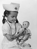 1960s Girl in Nurse Uniform Holding Stethoscope to Baby Doll Chest Indoor Photographic Print by H. Armstrong Roberts