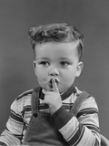 Little Boy Making Shush Shushing Quiet Silence Sign with Finger to Mouth Lips Photographic Print by H. Armstrong Roberts