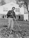 Smiling Man Raking Autumn Leaves in Front Yard of House Photographic Print by H. Armstrong Roberts