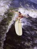 Young Man Red Swim Trunks Yellow Surfboard Riding a Wave Surfing Fotoprint van H. Armstrong Roberts