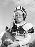 1960s Boy in Football Helmet and Pads Holding Ball Smiling Outdoor Photographic Print by D. Corson