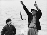 1950s-1960s Boy Son Fishing with Man Father or Grandfather Holding Up Caught Fish on Line Laughing Photographic Print by H. Armstrong Roberts