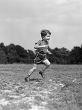 1940s Little Boy Running Playing on Grassy Field Photographic Print by H. Armstrong Roberts