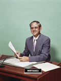 Smiling Man at Desk Holding Papers with Mortgage Officer Sign Photographic Print by H. Armstrong Roberts