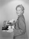 Smiling Woman Holding Wrapped Christmas Presents Photographic Print by H. Armstrong Roberts