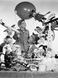 1950s Father with Son Holding Balloon Surrounded by Toys and Stuffed Animals Photographie par H. Armstrong Roberts