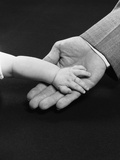 Man Hand Holding Supporting Baby Hand Photographic Print by H. Armstrong Roberts