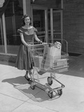 Smiling Woman Pushing Grocery Cart Out of Supermarket Photographic Print by H. Armstrong Roberts
