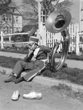 Teen Boy Band Uniform and Tuba Sitting on Curb with Shoes Off Photographie par H. Armstrong Roberts