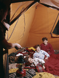 1960s Father with Lantern Checking Up on 3 Boys in Sleeping Bags Pajamas in Tent Reproduction photographique par D. Corson