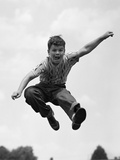 1950s Boy Jumping Up Photographic Print by H. Armstrong Roberts