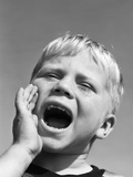 1950s Blond Boy with Eyes Closed and Hand Cupping a Wide Open Mouth Shouting Photographic Print by D. Corson
