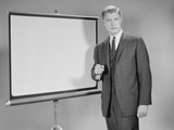 Man Standing Beside Blank Screen Ready for Presentation Photographic Print by H. Armstrong Roberts